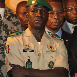 Coup leader Capt. Amadou Haya Sanogo stands at junta headquarters during an address to the press, in Kati, outside Bamako, Mali, Friday, April 6, 2012. Under intense pressure from the nations bordering Mali, Sanogo, the junior officer who seized control of the country in a coup last month signed an accord agreeing to return the country to constitutional rule. The announcement was made late Friday, only hours after separatist rebels in the country's distant north declared their independence.