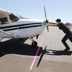 Jason Clark, of Bountiful, prepares to take members of the media on a flight during the Skypark Aviation Festival and Expo at Skypark Airport in Woods Cross on Friday, June 2, 2017. The expo is Utah's largest annual aviation event.