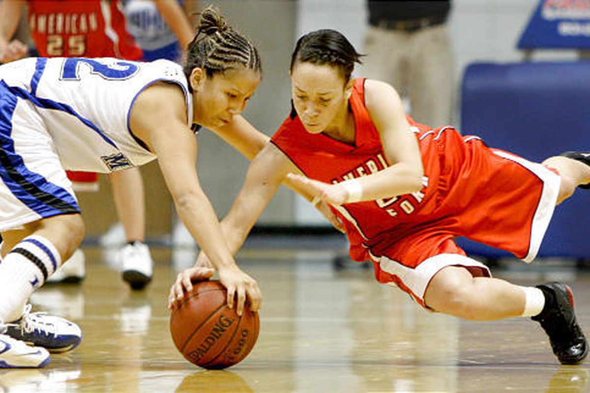 American Fork's Nikki Ybarra, right, dives for the loose ball after stealing it from Bingham's Nicole Yazzie during Class 5A state basketball action Thursday at SLCC.