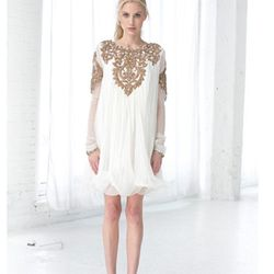 """""""Ditch the sparklers and <em>be</em> the sparkle. 4th of July doesn't have to translate into shorts and a t-shirt. Why not kick it up a notch and shine in a chic number from local designer <a href=""""http://azeeza.us/"""">Azeeza Khan</a>."""" [Photo: via Azeeza]"""