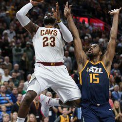 Cleveland Cavaliers forward LeBron James (23) lays it up ahead of Utah Jazz forward Derrick Favors (15) at Vivint Arena in Salt Lake City on Saturday, Dec. 30, 2017.