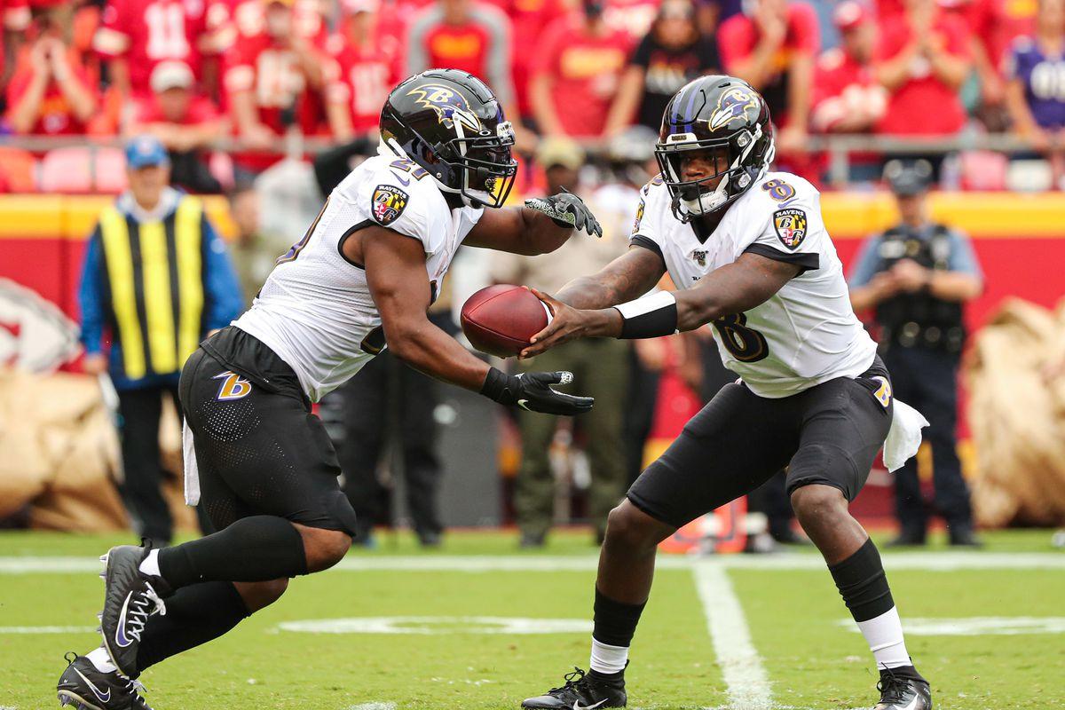 Baltimore Ravens quarterback Lamar Jackson hands off to running back Mark Ingram during the first half against the Kansas City Chiefs at Arrowhead Stadium.