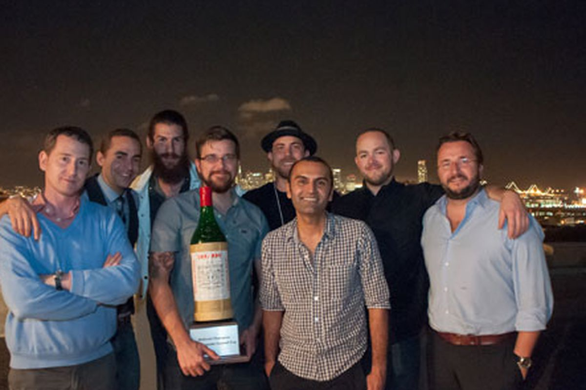 Clint Rogers, flanked by the other contestants, holds the first-ever Luxardo Cocktail Cup