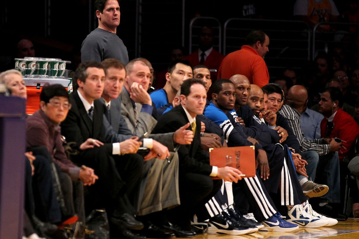 Terry Stotts is the out of focus dude sitting in front of Rick Carlisle. You deserve a better picture moment then this, Terry boy.