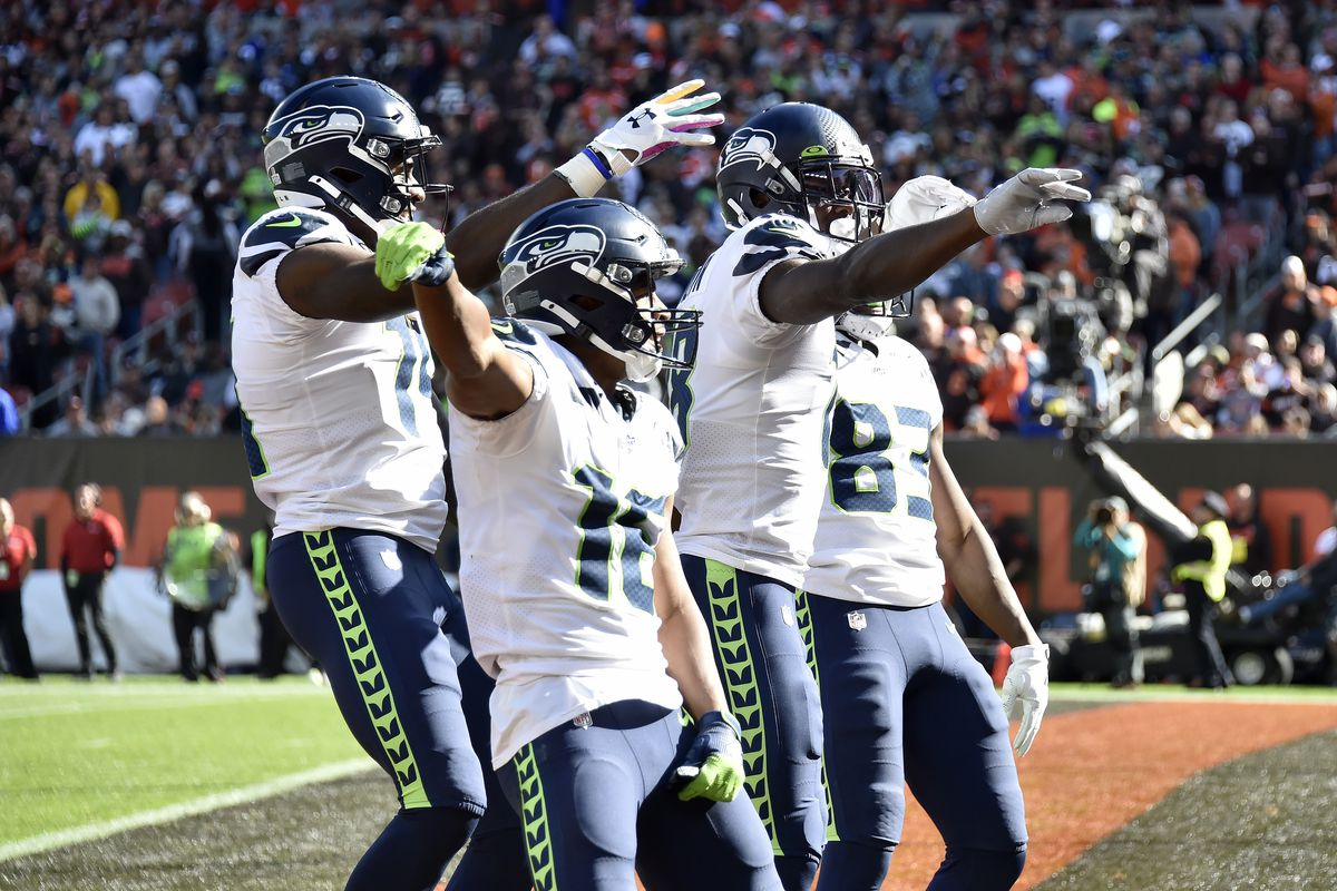 Tyler Lockett, D.K. Metcalf, Jaron Brown, and David Moore of the Seattle Seahawks celebrate after Brown scored during the second quarter against the Cleveland Browns at FirstEnergy Stadium on October 13, 2019 in Cleveland, Ohio.