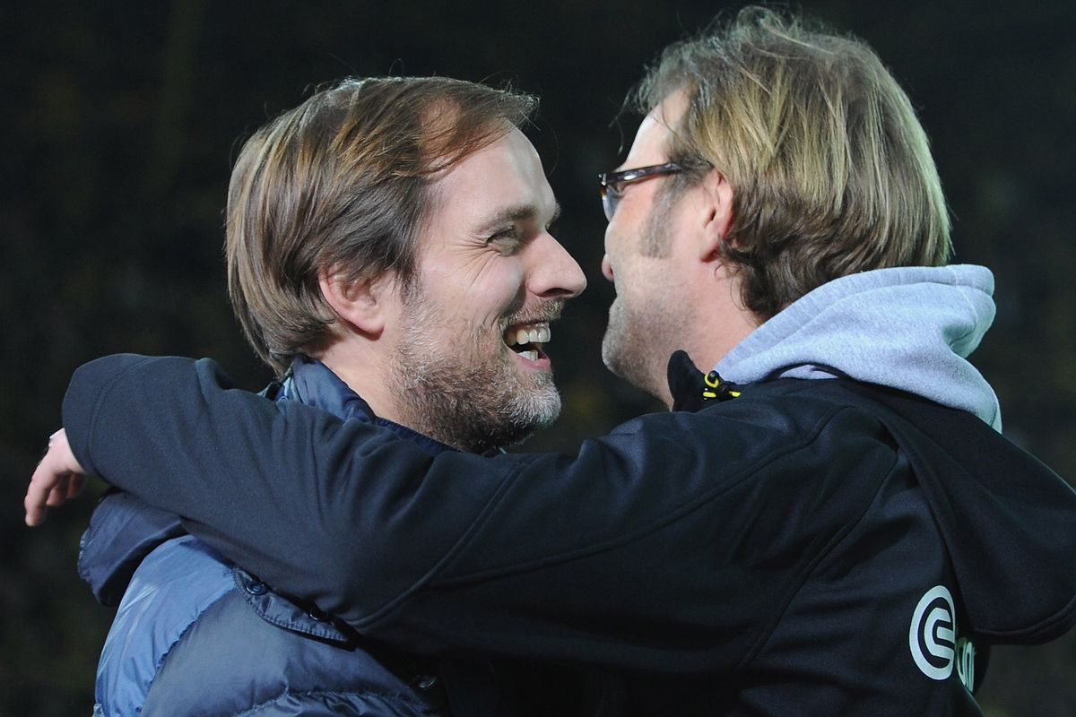 Klopp and Tuchel embrace in 2012 — back when the Chelsea manager was at Mainz 05, where then-Borussia Dortmund's manager started his managerial career