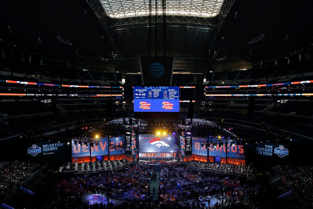 ARLINGTON, TX - The Denver Broncos logo is seen on a video board during the first round of the 2018 NFL Draft at AT&T Stadium.