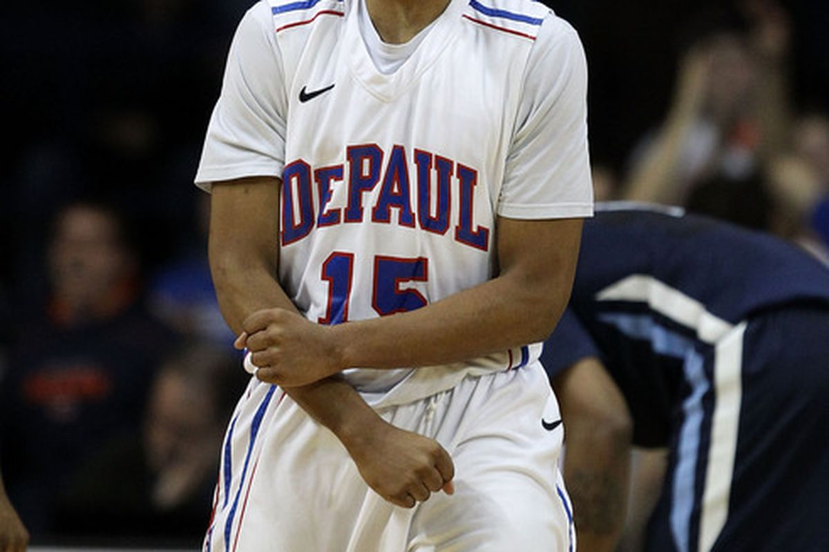 ROSEMONT IL - FEBRUARY 19: Moses Morgan #15 of the DePaul Blue Demons celebrates a foul by the Villanova Wildcats at the Allstate Arena on February 19 2011 in Rosemont Illinois.