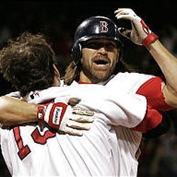 Red Sox Johnny Damon is congratulated at the plate by teammate Doug Mientkiewicz after scoring the game-winning run.