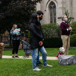 Pets and their owners attend a pet blessing ceremony in celebration of the feast day of St. Francis of Assisi, the patron saint of the environment and pets, outside Our Lady of Mt. Carmel Church in Lake View East Saturday morning.