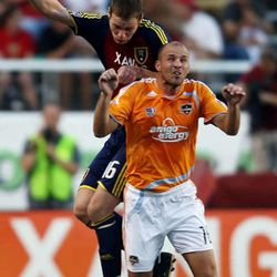 Reals's #16 Kenny Deuchar (behind) and Houston's #16 Craig Waibel jump for the ball as Real Salt Lake battles the Houston Dynamo in MLS Soccer action at Rice Eccles Stadium July 3, 2008 Photo by Scott G. Winterton