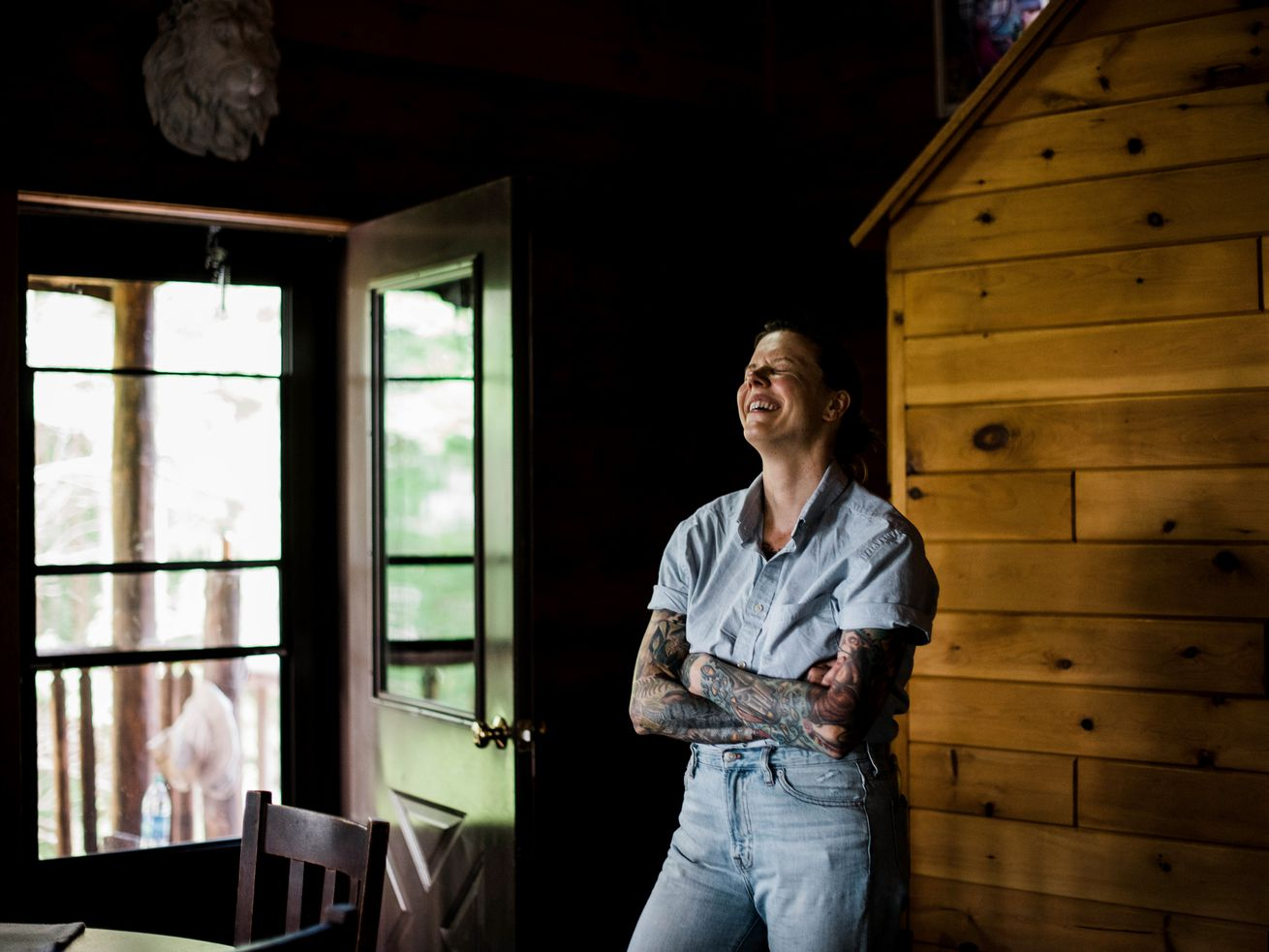 NAHMA TOWNSHIP, MI - JULY 27: The Milkweed Inn is located over 23 miles off the main road and can only be accessed with a 4-wheel drive vehicle. Chicago chef Iliana Regan, who has just written a memoir, and her wife, Anna Regan, opened up their rustic cabin in Michigan's Upper Peninsula to guests who will get an all-inclusive food and wine experience. Iliana Regan laughs with guests inside their inn.