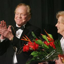 James LeVoy Sorenson applauds as his wife Beverly looks on, after Sorenson was given the Giant In Our City award during a banquet at the Grand America Hotel Feb. 15, 2006 in Salt Lake City. Beverley Taylor Sorenson, a longtime philanthropist, advocate for arts education and member of one of the wealthiest families in Utah, died at age 89 of natural causes Monday, May 27, 2013.