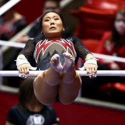 Cristal Isa performs her bars routine as Utah and Washington compete in an NCAA gymnastics meet at the Huntsman Center in Salt Lake City on Saturday, Jan. 30, 2021. No. 4 Utah won 197.475 to 193.300.