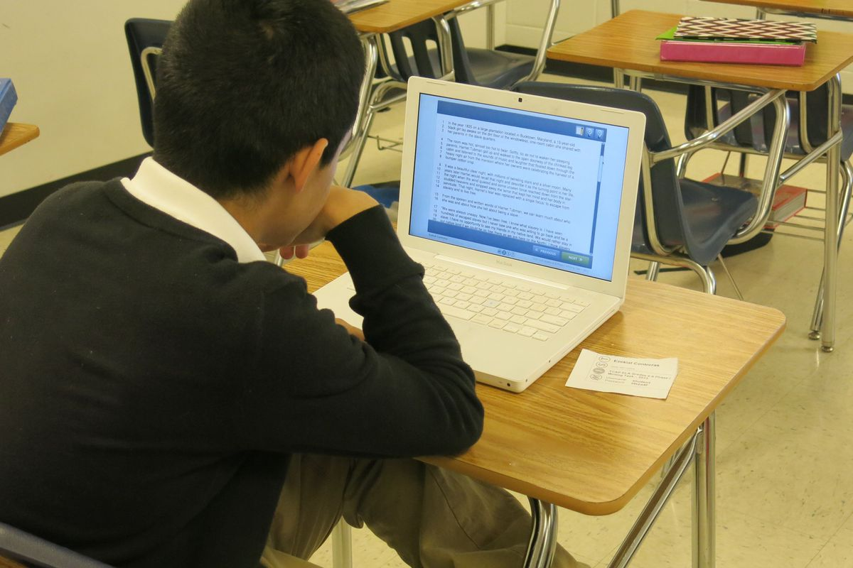 A Colonial Middle School student takes a practice writing test online in January 2014.