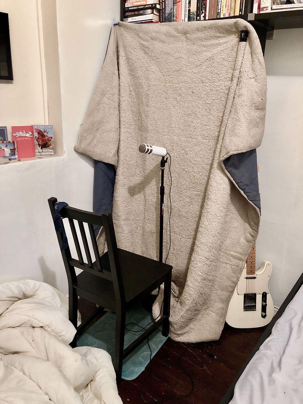 A sad chair facing a sad blanket