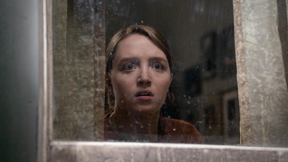 Kiera Allen looks fearfully out of a window in Hulu's Run