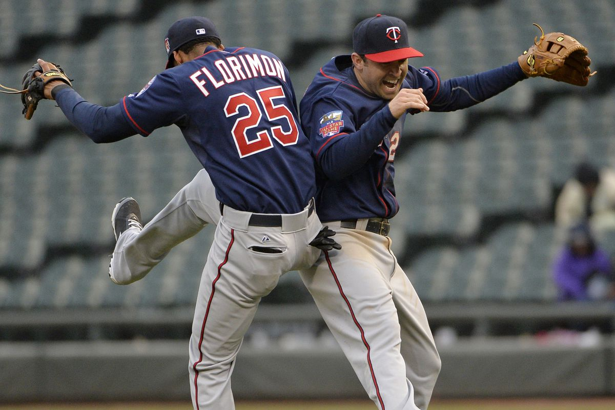 Florimon and Dozier celebrate after Thursday's victory over the White Sox
