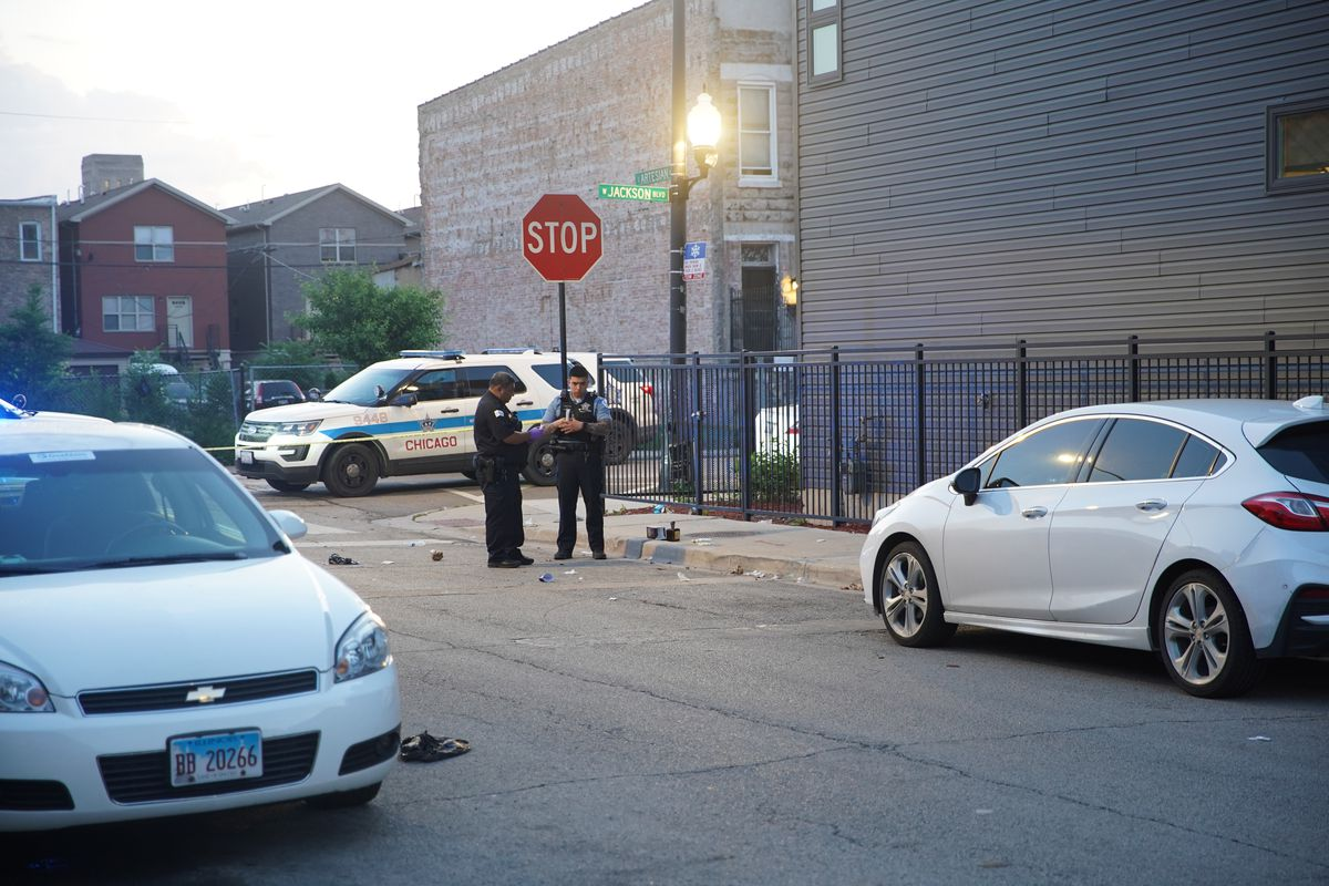 Police at the scene of a shooting on the Near West Side