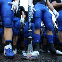 Lincoln-Way East's Danny Scianna carries a sledgehammer onto the field. Allen Cunningham/For the Sun-Times.
