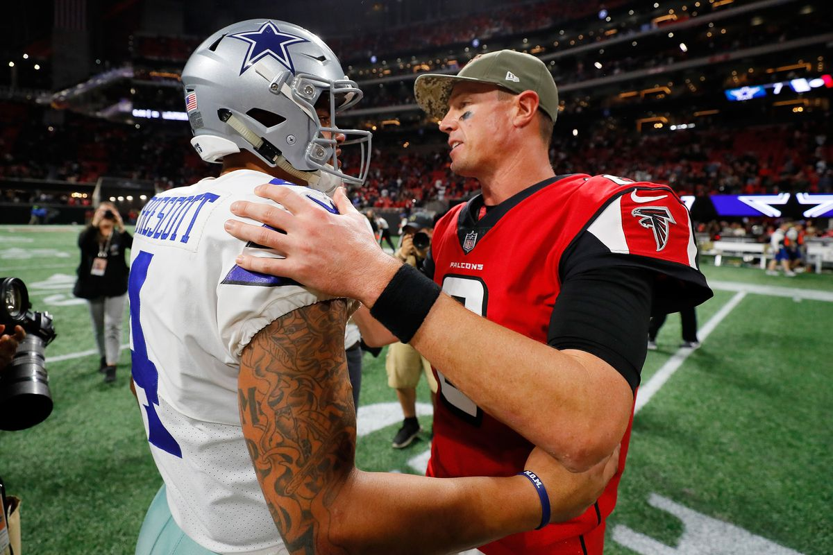 Matt Ryan of the Atlanta Falcons shakes hands with Dak Prescott of the Dallas Cowboys after the game at Mercedes-Benz Stadium on November 12, 2017 in Atlanta, Georgia.