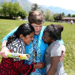 Jood Alhammashi and Aline Nkuzimana say goodbye to fourth-grade teacher Kelly Kline on the last day of school at Crestview Elementary in Holladay on Friday, May 27, 2016.