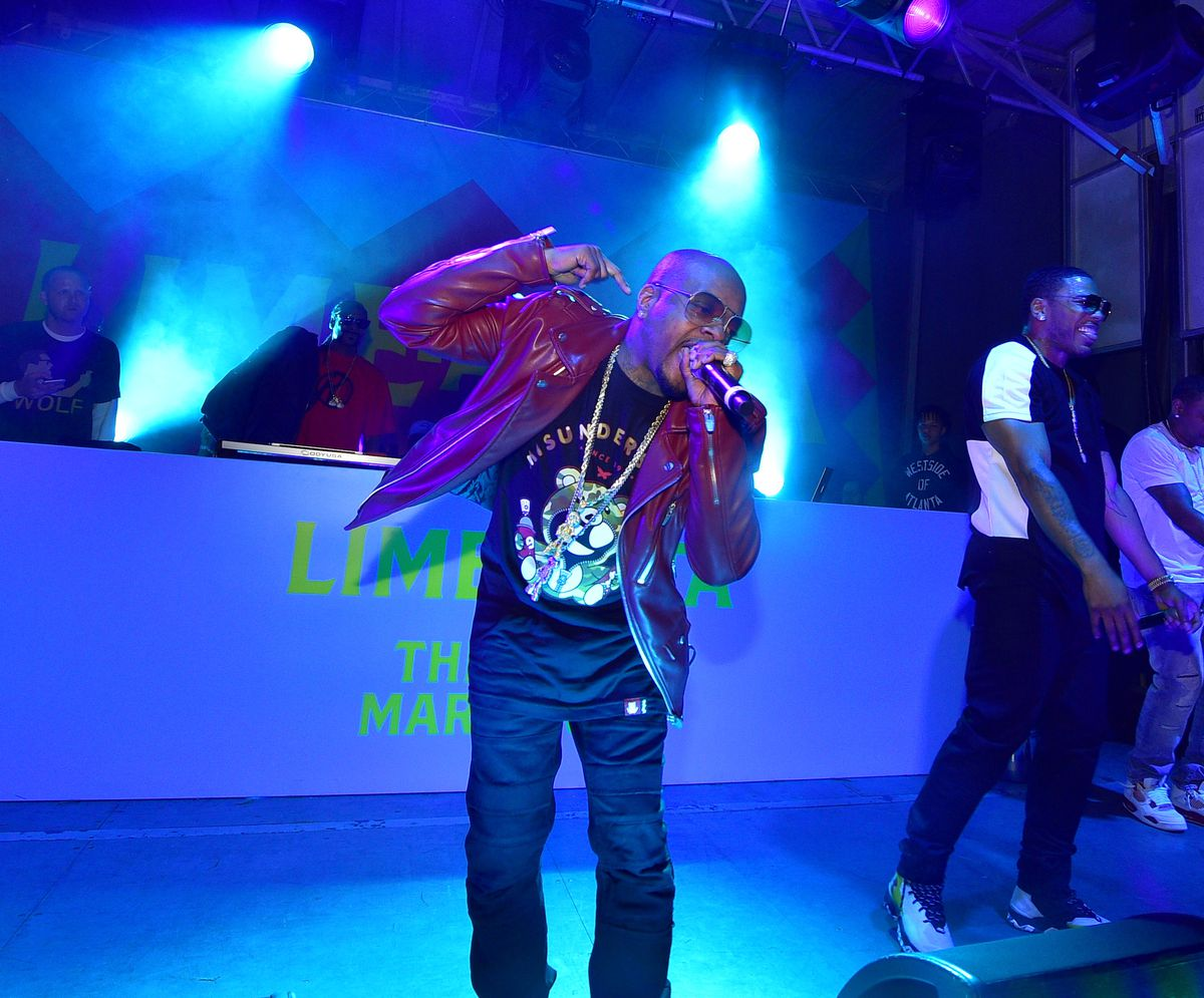 Celebrity Culture: Jermaine Dupri with a mic performing with Nelly at Immense Sky Buckhead in Atlanta in 2016.