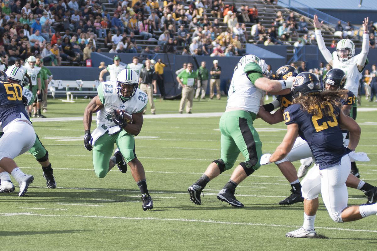 Marshall's Tony Pittman (23) rumbles in for his first touchdown of the season.