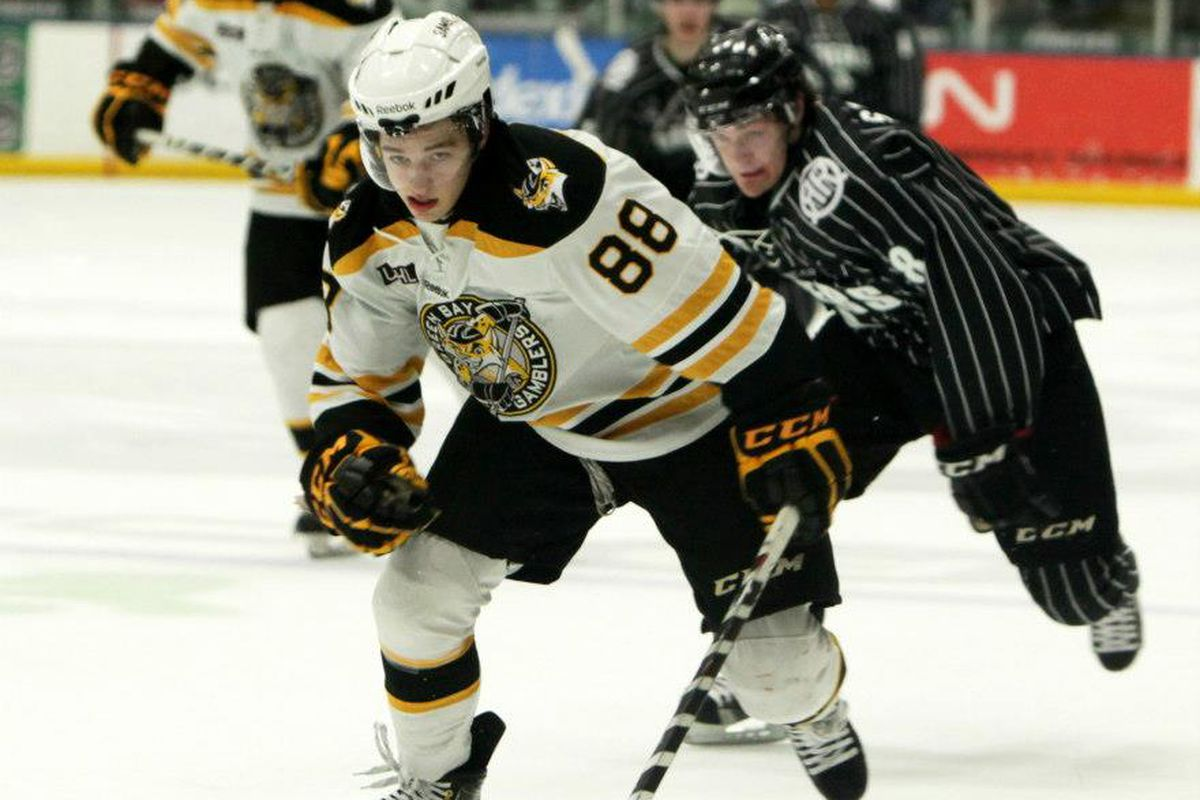 Badgers defense recruit Jake Linhart chases down a loose puck