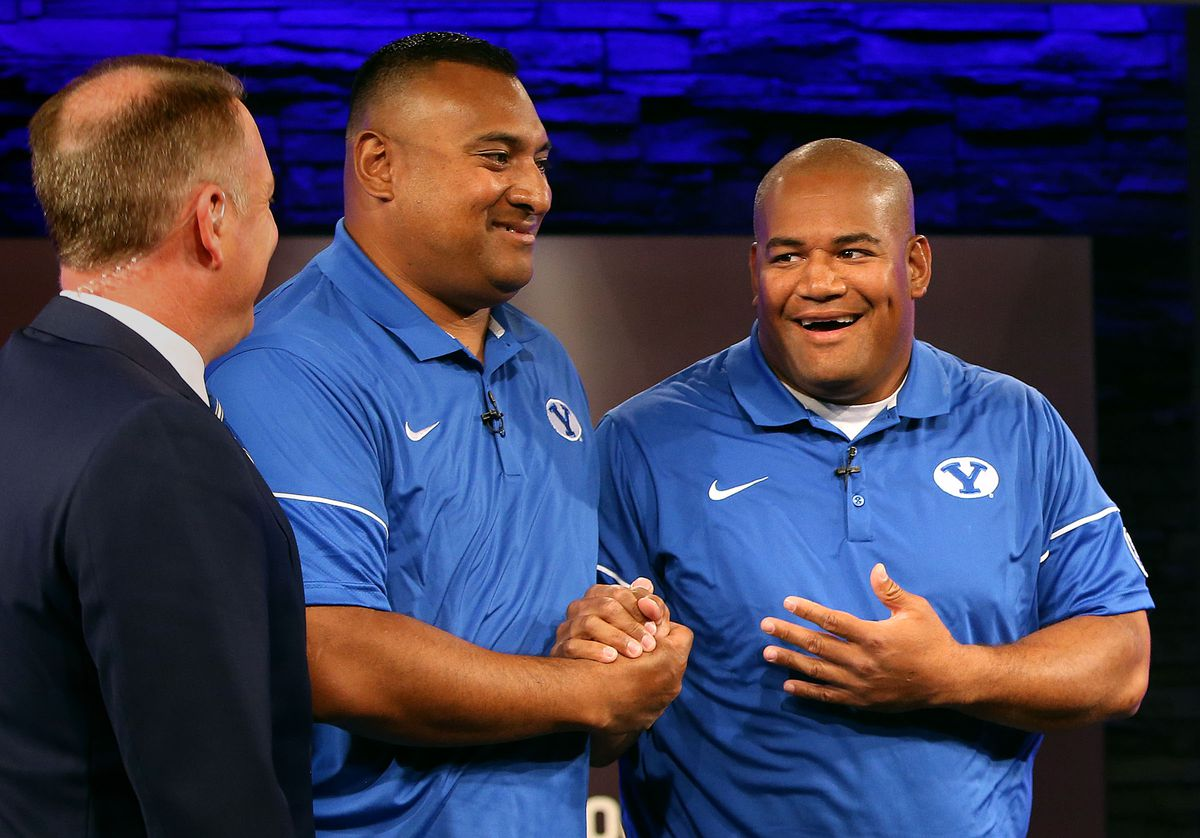 Kalani Sitake, head coach, and Ilaisa Tuiaki, BYU defensive coordinator and defensive line coach, shake hands during BYU media day at BYU Broadcasting in Provo on Friday, June 23, 2017.