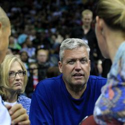 New York Jets football head coach Rex Ryan talks to fans as he sits with wife his wife Michelle Ryan, second from left, while watching the New Jersey Nets play the Boston Celtics in an NBA basketball game in Newark, N.J., Saturday, April 14, 2012. Celtics won 94-82.