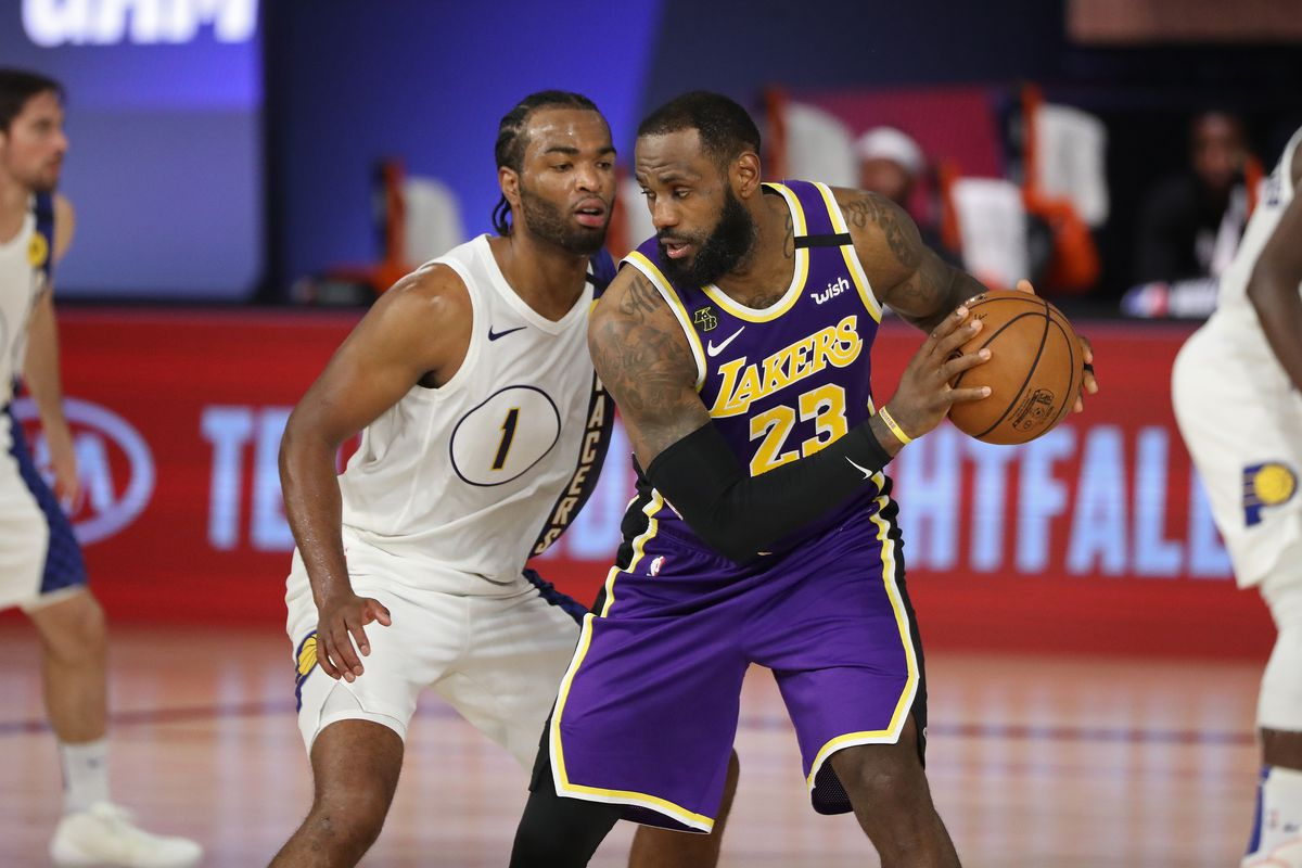 LeBron James of the Los Angeles Lakers handles the ball against the Indiana Pacers on August 8, 2020 at The Field House at ESPN Wide World of Sports in Orlando, Florida.