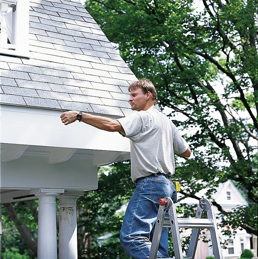 Man Snapping Chalk Line For Rain Gutters