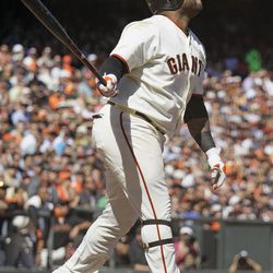 San Francisco Giants' Pablo Sandoval hits a three-run homer off Colorado Rockies relief pitcher Edgmer Escalona during the fourth inning of their baseball game in San Francisco, Thursday, Sept. 20, 2012.