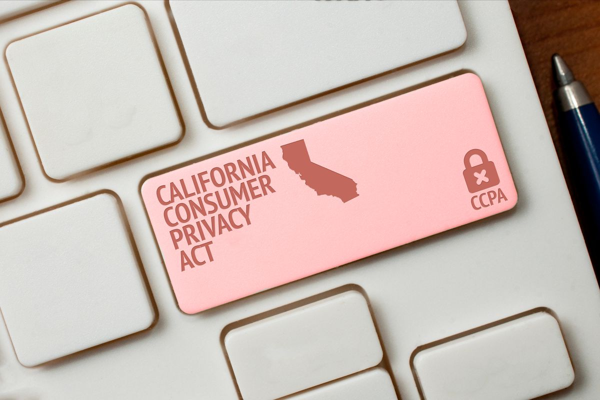 """An illustration showing a computer keyboard with a key marked """"California Consumer Privacy Act"""" and a picture of a padlock."""