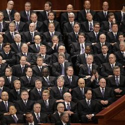 Members of the Mormon Tabernacle Choir look on during the 183rd Annual General Conference of The Church of Jesus Christ of Latter-day Saints Saturday, April 6, 2013, in Salt Lake City. The Mormon church is planning to build two new temples in Rio de Janeiro and Cedar City, Utah. The faith's president, Thomas S. Monson, announced the new temples on Saturday during the 183rd semi-annual general conference of The Church of Jesus Christ of Latter-day Saints. More than 100,000 members of the church have gathered in Salt Lake City to hear words of inspiration and guidance for daily living from the faith's senior leaders.  (AP Photo/Rick Bowmer)