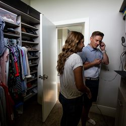 """Savanna Shaw and Mat Shaw record a cover of the song """"Shallow"""" inside a closet in their family's home on Thursday, May 14, 2020. The father-daughter duets went viral on YouTube as they shared their passion for music amid the COVID-19 pandemic. """"The one thing more contagious than a virus is hope and so we're just doing our small part in the world to spread some hope,"""" Mat Shaw said."""