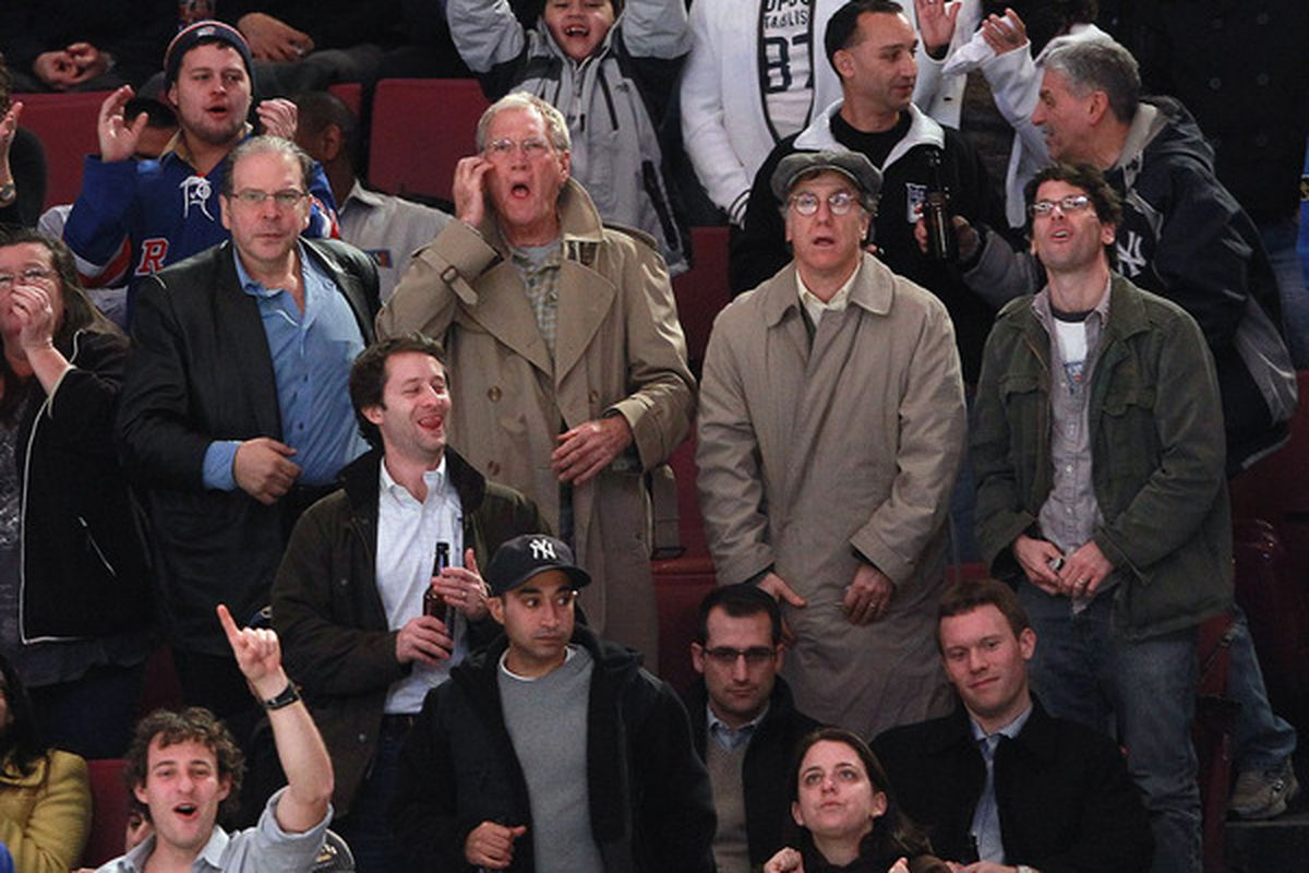 NEW YORK - NOVEMBER 11:  David Letterman (2nd from left) takes in the hockey game between the Buffalo Sabres and the New York Rangers at Madison Square Garden on November 11 2010 in New York City.  (Photo by Bruce Bennett/Getty Images)