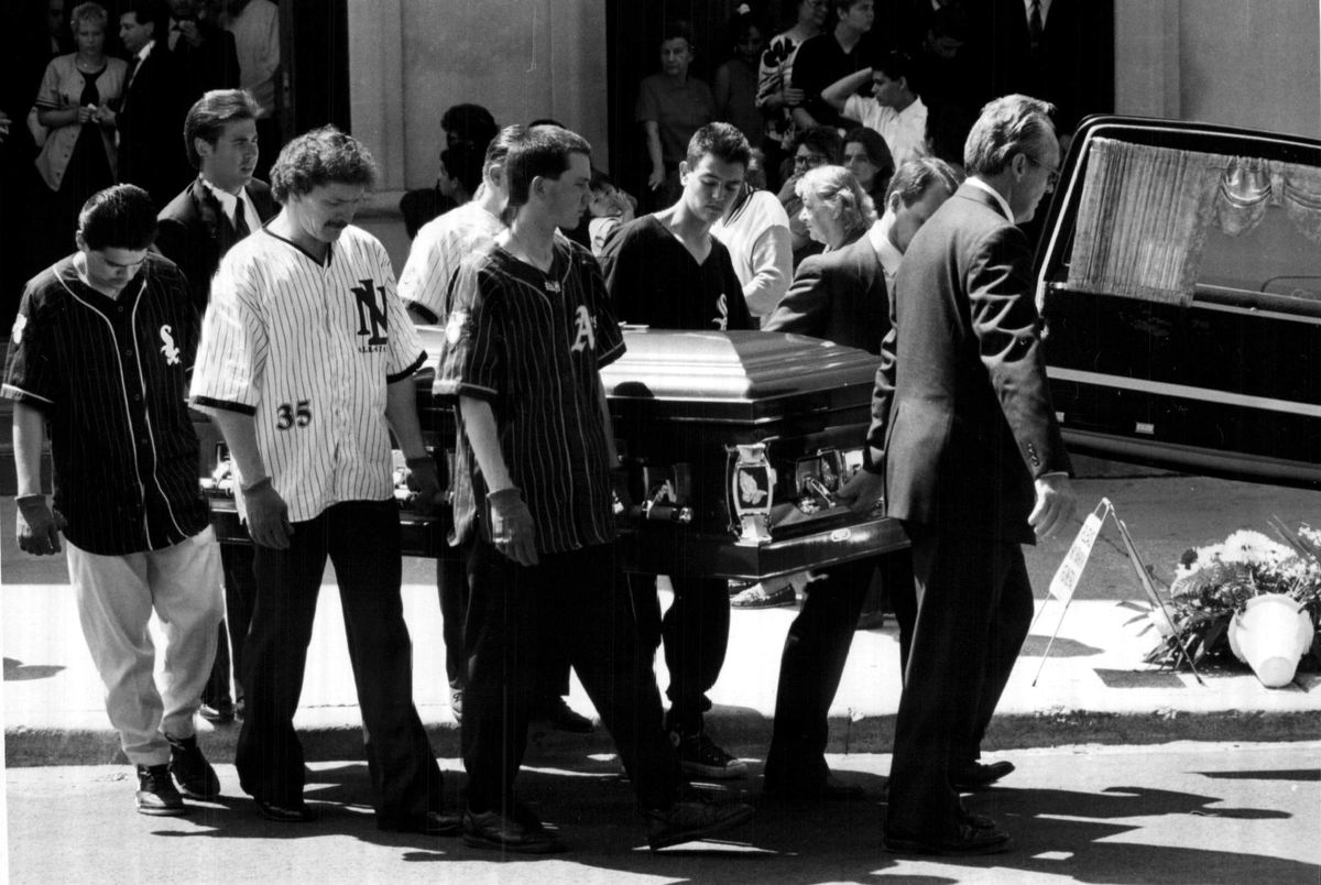 Pallbearers five of them wearing baseball shirts carry Joey Chlopek's coffin to a hearse Thursday after mass at St. pancratius Church, 4025 S. Sacramento Ave. on June 11, 1992.