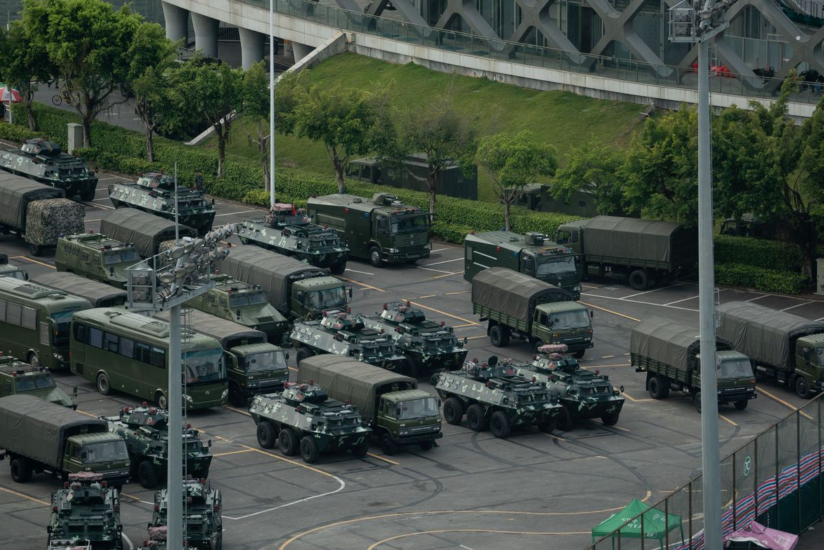 Military vehicles clog a street in Shenzhen, China.