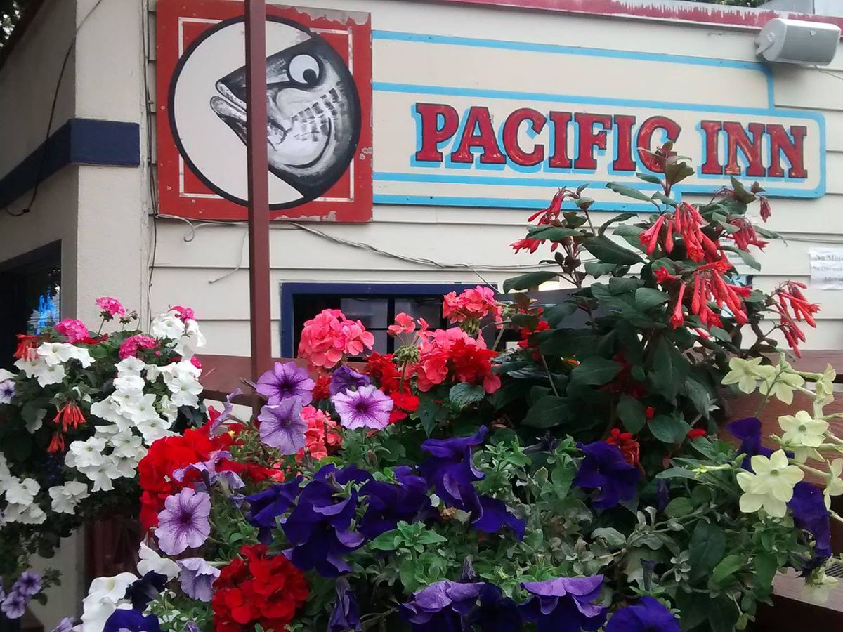 The exterior of Pacific Inn Pub, with the restaurant's name and logo of a fish.