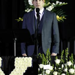"""Dallyn Bayles sings """"Danny Boy"""" during a public memorial service for former Cougar football coach LaVell Edwards at the Provo Convention Center on Friday, Jan. 6, 2017."""
