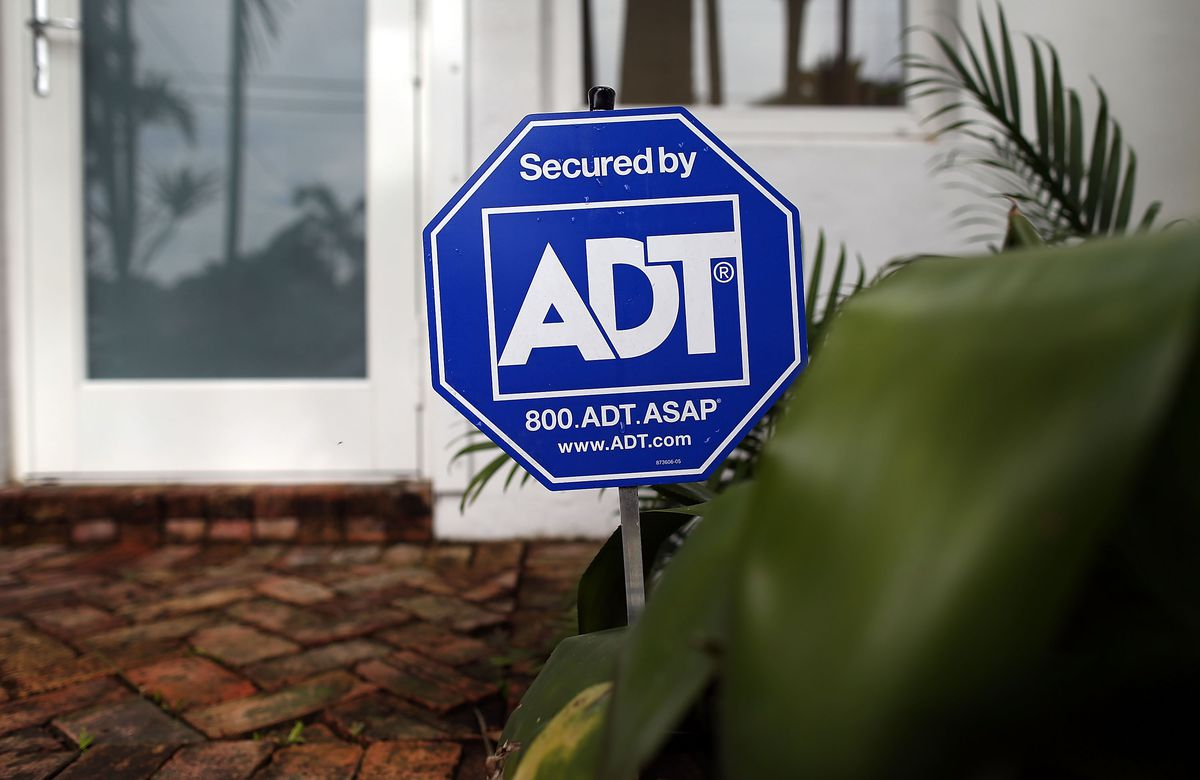 An ADT yard sign.