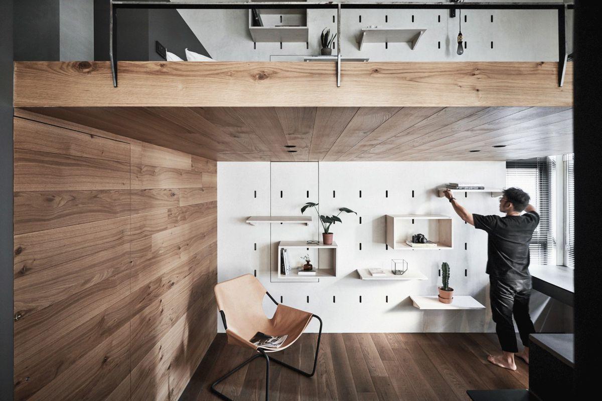 Man hanging shelves