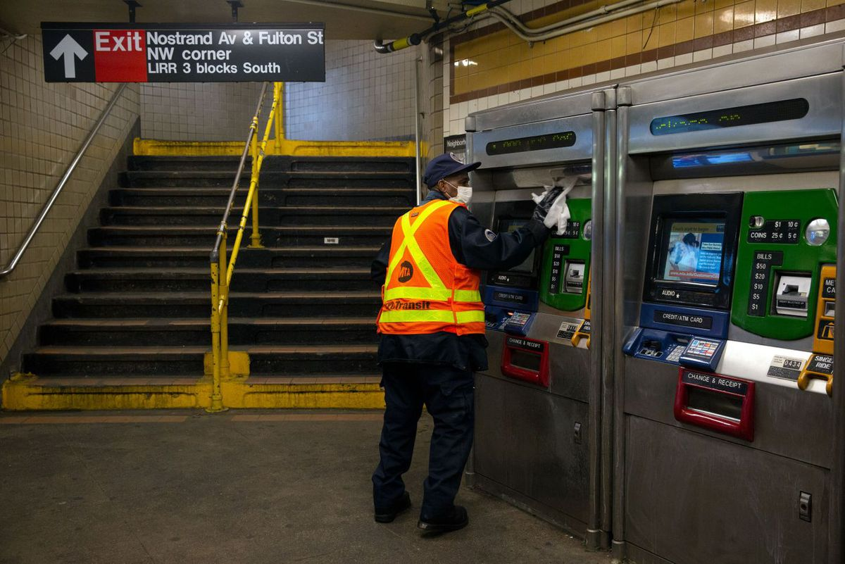 An MTA workers disinfects the Nostrand Avenue station during the coronavirus outbreak.