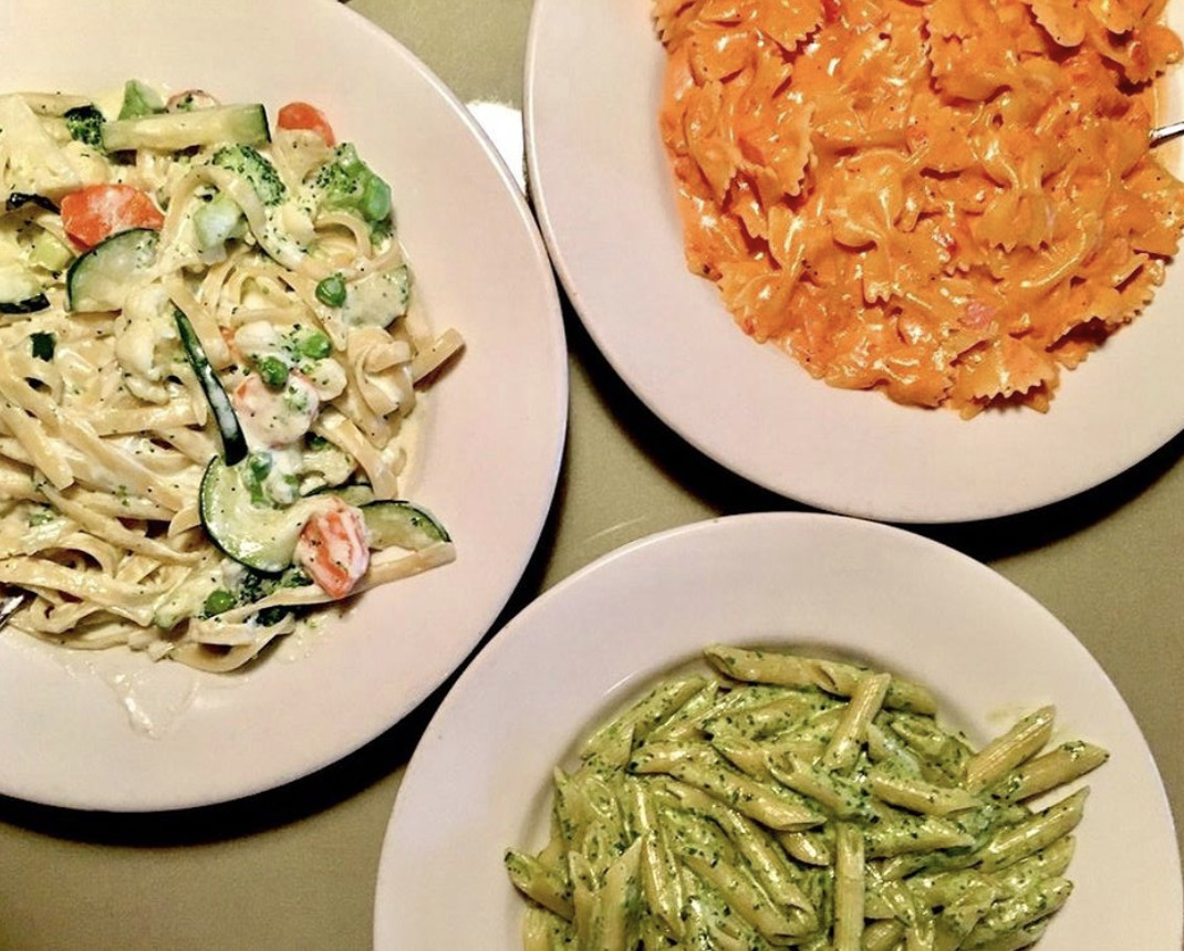 A trio of pastas shown from above, including a bowtie with vodka sauce.