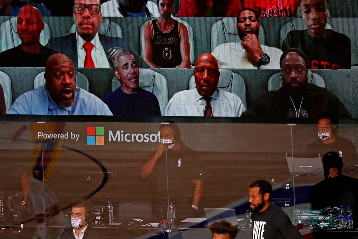 The video board shows Shaquille O'Neal, Barack Obama and Dwayne Wade during the first quarter in game one of the 2020 NBA Finals between the Los Angeles Lakers and the Miami Heat at AdventHealth Arena.