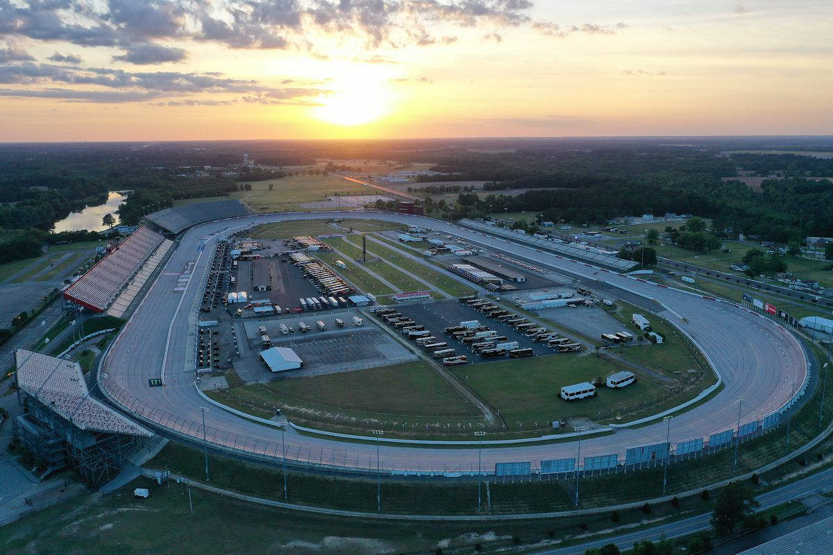 The sun sets at Darlington Raceway on May 16, 2020 in Darlington, South Carolina. NASCAR is preparing to resume the season with a race tomorrow after the nationwide lockdown due to the ongoing Coronavirus (COVID-19).