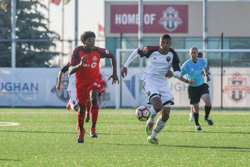 USL Photo - TFC II's Dunn races Ottawa's Dos Santos for a loose ball