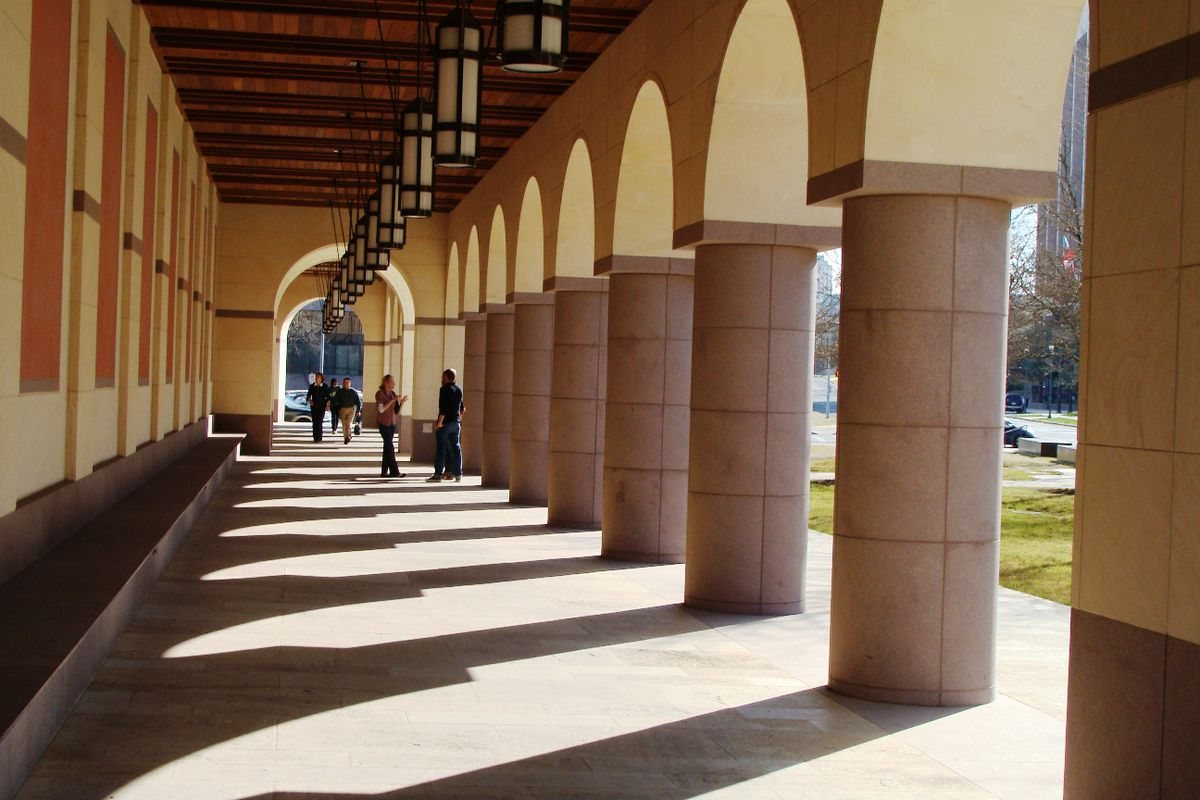 Large covered walkway/ colonnade outside Blanton Museum